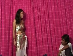 Indian bitch is fro on her Knees engulfing penis
