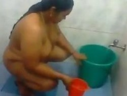 Large Indian Woman Washing Will not hear of Fat Throng
